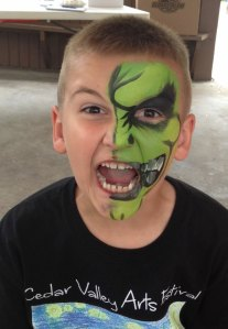 Boy in green face paint